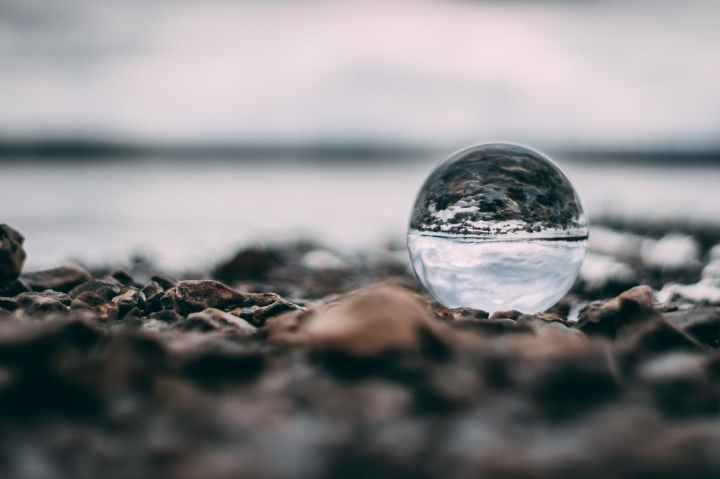 macro photography of water on sand